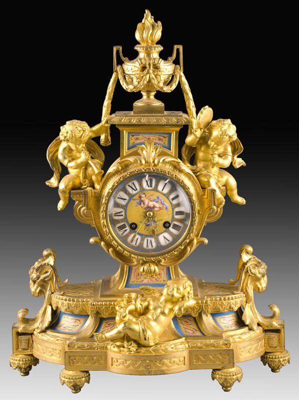13: French gilt bronze figural clock with Sevres style