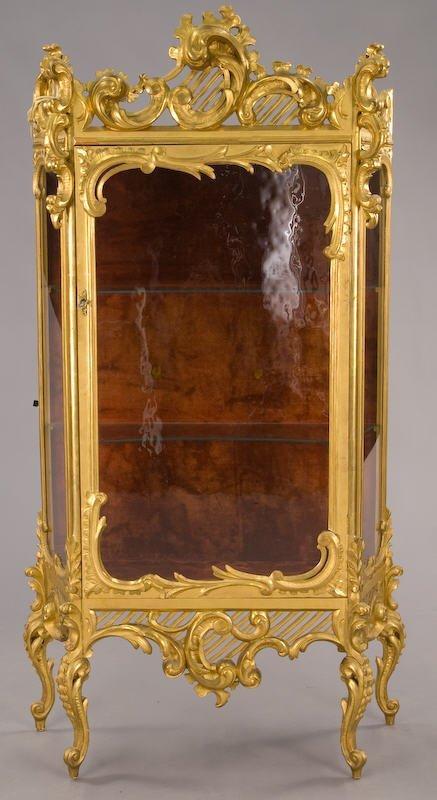 22: Italian style carved, gilt vitrine with multiple