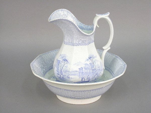 409B: (2)pcs. Blue and white pottery pitcher