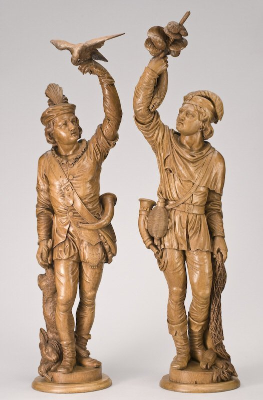 12: Pr. Continental carved wood sculptures,