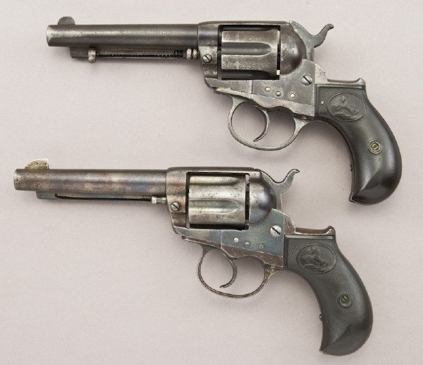 "37: (2) Colt model 1877 ""Lighting"" revolvers"