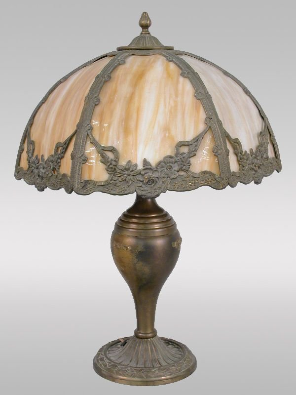 12: A six panel slag glass table lamp in a gilt