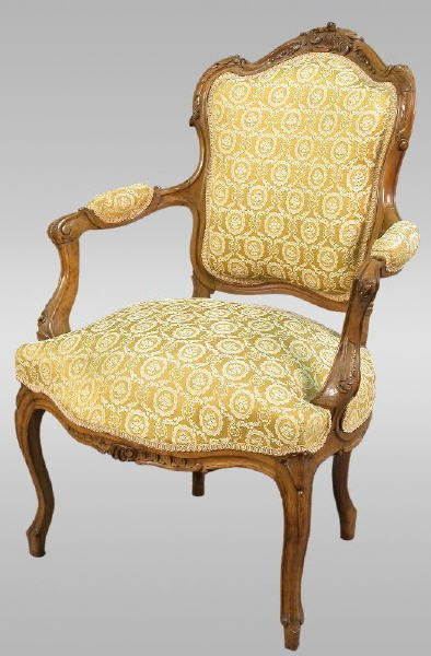 18: French walnut armchair with carved crest,