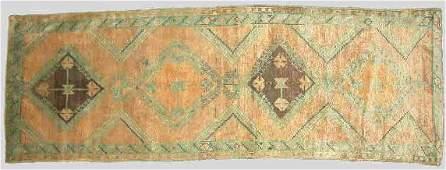 29: An Antique Turkish Oriental rug in shades of