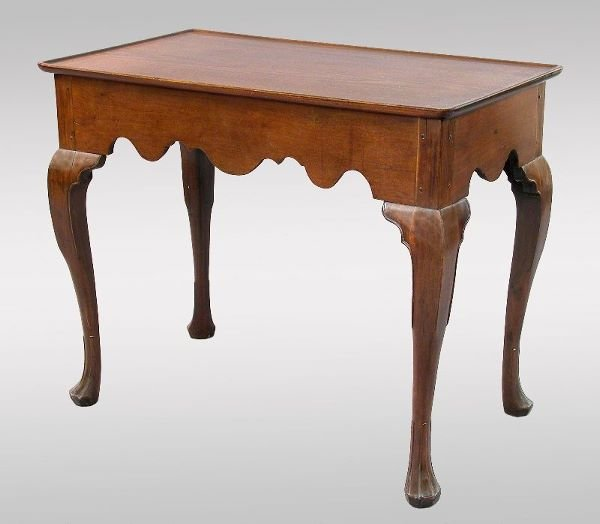 196: A New England Queen Anne walnut tea table having