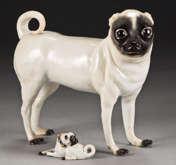 1: (2) Meissen porcelain figures modeled as pug dogs.