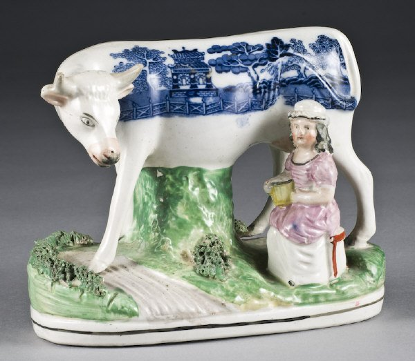 8: Rare Staffordshire figure of a cow and a milk