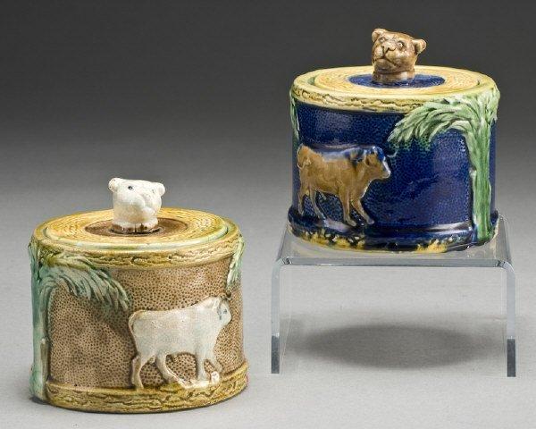 13: (2) Majolica sugar bowls decorated with cows,