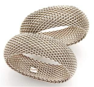Pr. Tiffany & Co. sterling silver mesh bangles.