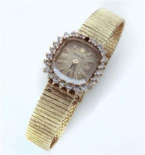 Rolex 14K gold & diamond ladies wristwatch.