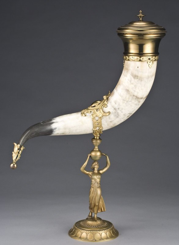 1: Gilt metal and horn cornucopia on stand, the stand h