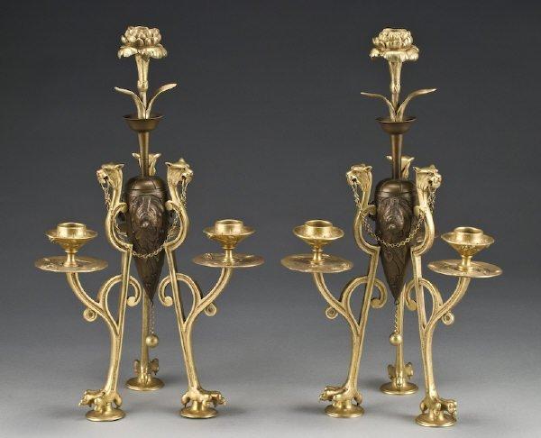 15: Pr. Gilt and patinated bronze candelabra the centra
