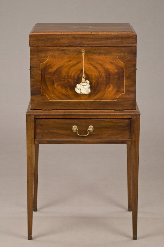 9: American flame mahogany silver chest on stand