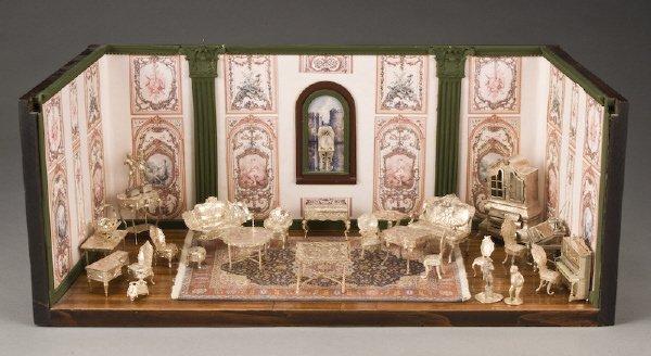 14: 30 Pc.. Miniature silver furniture in a diorama