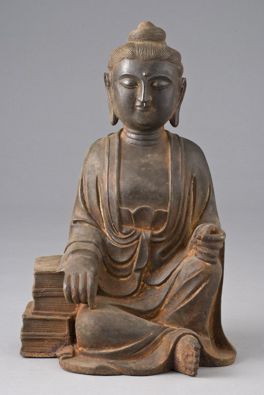 11: Chinese Qing cast iron Guanyin seated with right