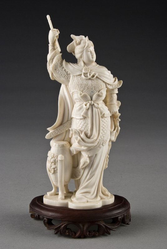 12: Chinese carved ivory lady warrior depicting the