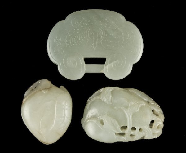 23: (3) Chinese carved jade pendants depicting a