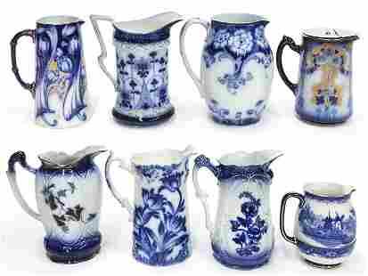 (8) Antique flow blue pitchers.