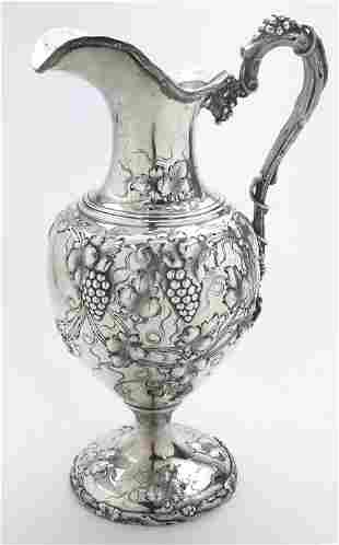 Hendrick sterling silver water pitcher.
