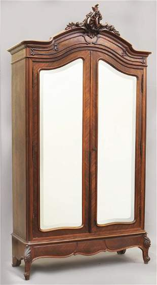 Antique French carved walnut armoire