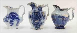 (3) Large antique English flow blue water pitchers