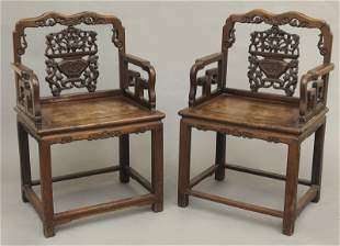 Pr. Chinese Qing rosewood arm chairs,