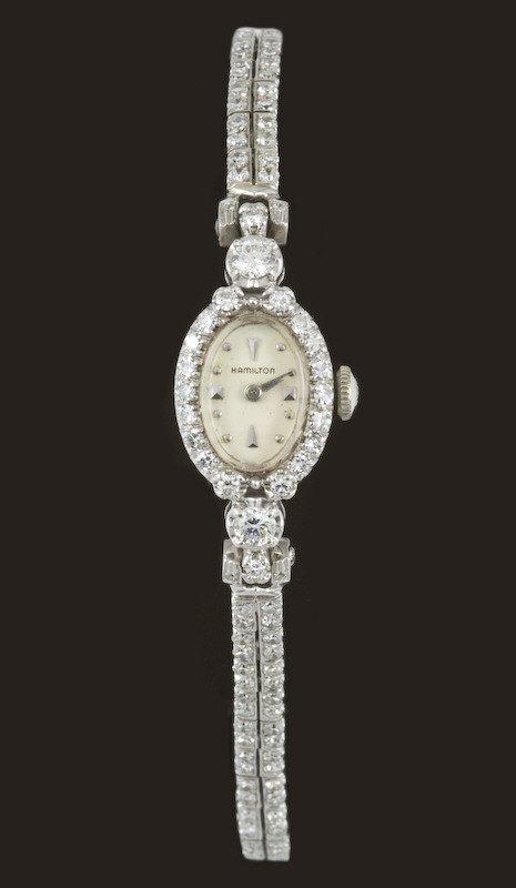 9: Retro ladies 14K gold and diamond Hamilton watch,