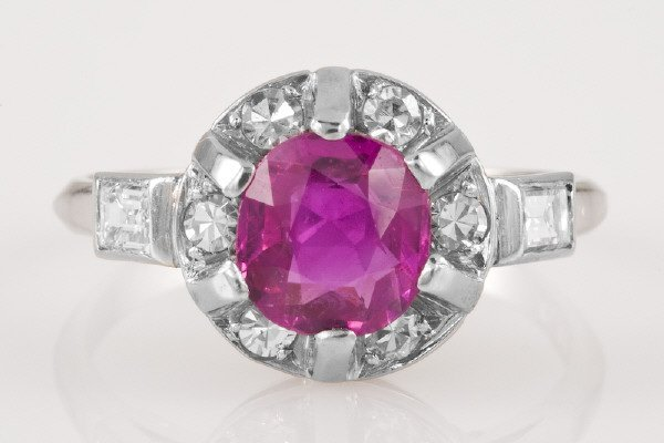16: Retro platinum, diamond and ruby ring featuring