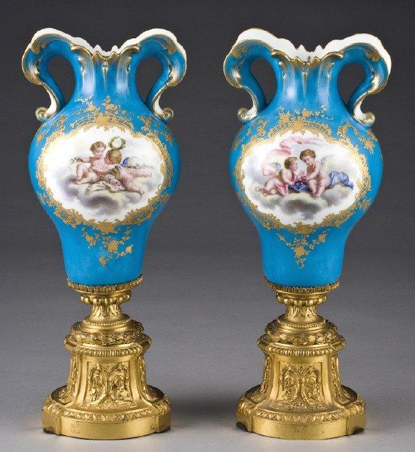 17: Pr. Sevres style porcelain urns