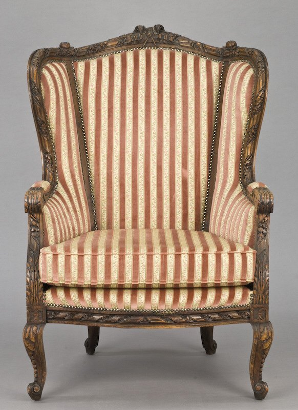 18: Large French bergere with carved frame