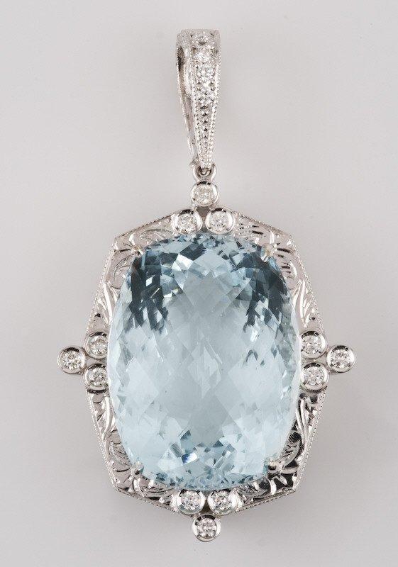 23: 14K gold, aquamarine and diamond pendant