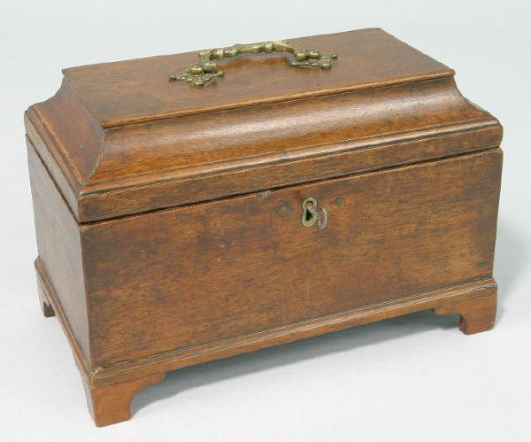 3: An English mahogany tea caddy with a lift lid,