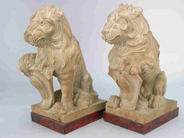 9: Pair of carved wooden lions seated on wooden bases