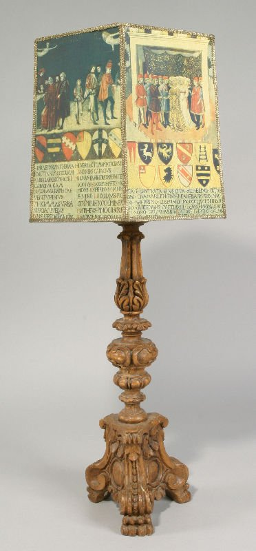 16: A highly carved wooden table lamp resting on