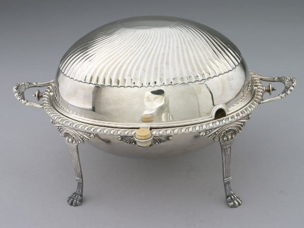 17: A silver plated revolving breakfast server the top