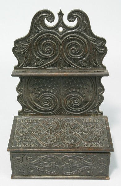 22: A highly carved dark finished oak spoon rack with