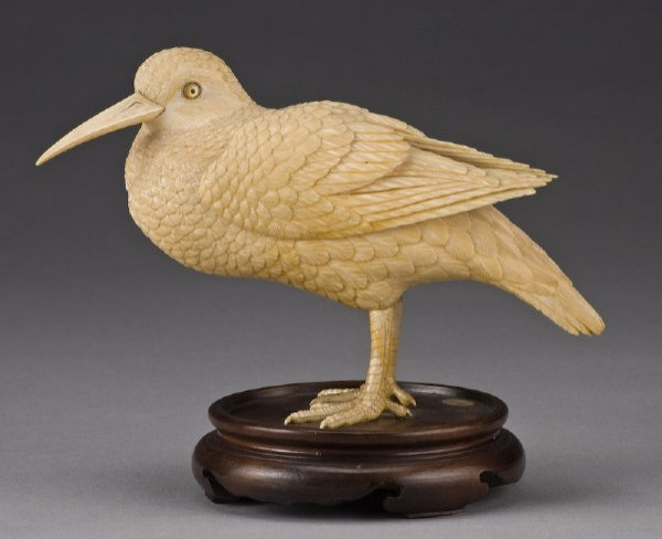 8: Japanese Meiji carved ivory kingfisher raised on a