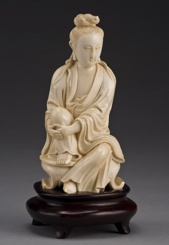 282: Chinese carved ivory seated beauty carved with