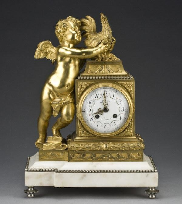 24: French gilt bronze and marble mantle clock