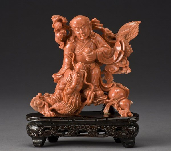 1: Chinese carved red coral sculpture depicting a