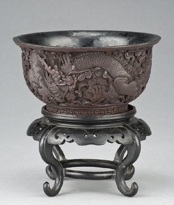 6: Chinese Qing carved cinnabar bowl depicting two