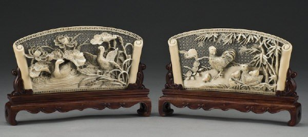 24: Pr. Carved ivory plaques depicting chicken and