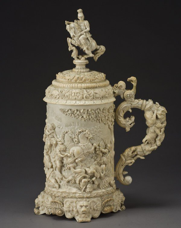 159: Large German ivory tankard and cover depicting the