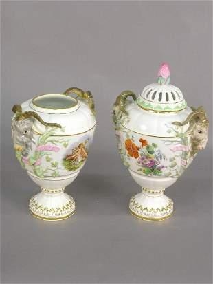 Pair of German porcelain lidded urns