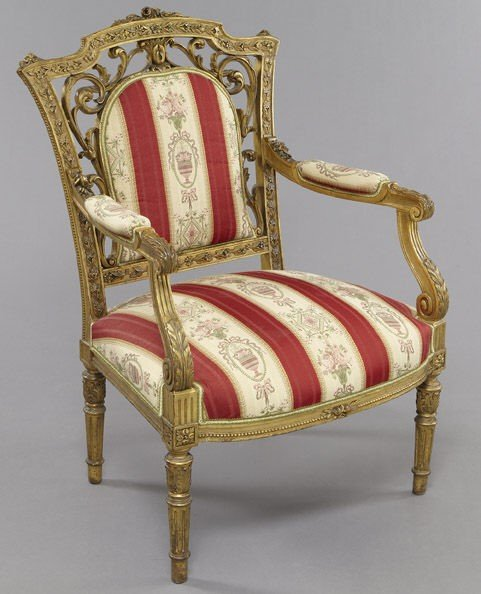 7: Continental carved and gilt wood arm chair