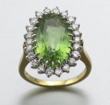 17: Platinum, 18K gold, diamond and peridot ring