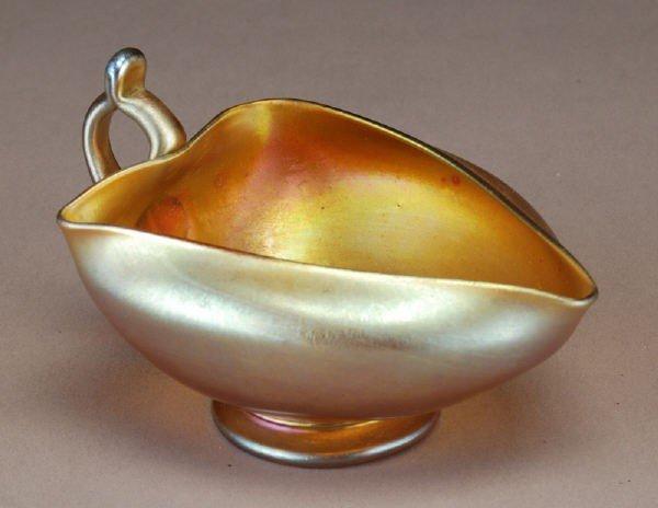 19: Tiffany gold Favrile glass cream pitcher,