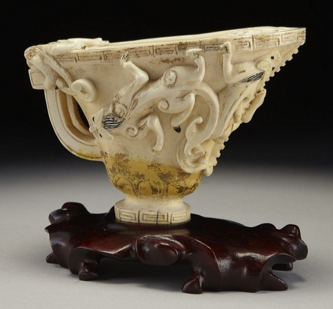 19: Chinese Qing carved ivory libation cup depicting (I