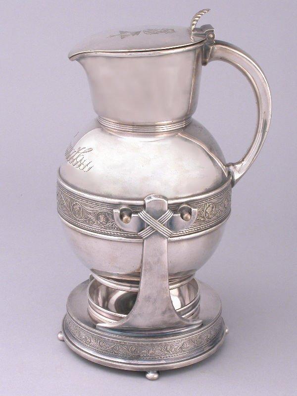 3: A Gorham silver plate tilting tea kettle, the lid