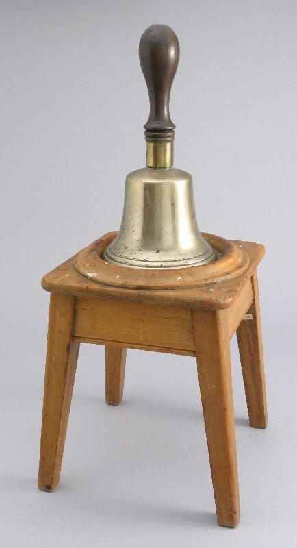 8: English brass school bell on pine stand / stool